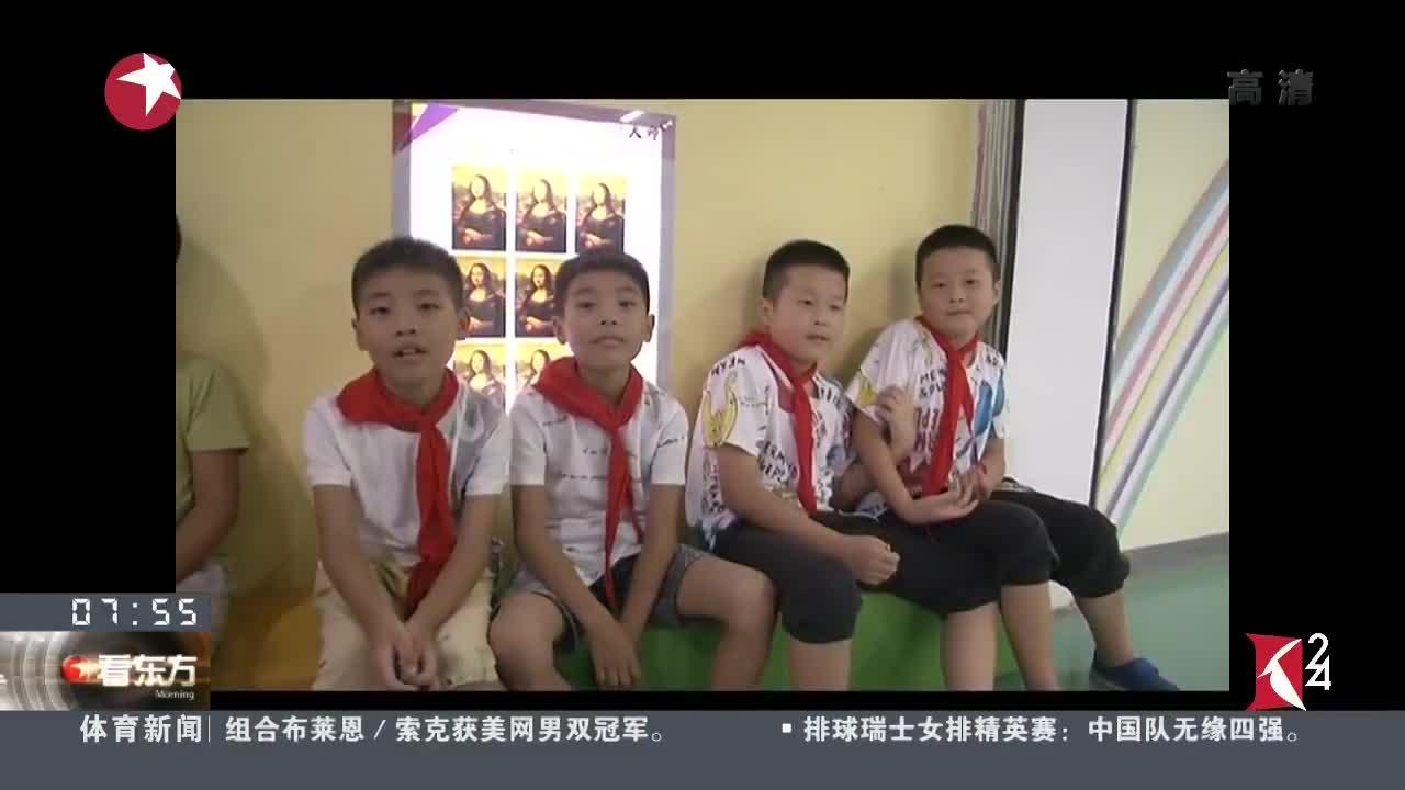 """[视频]武汉:一所小学15对双胞胎 上演真人版""""连连看"""""""