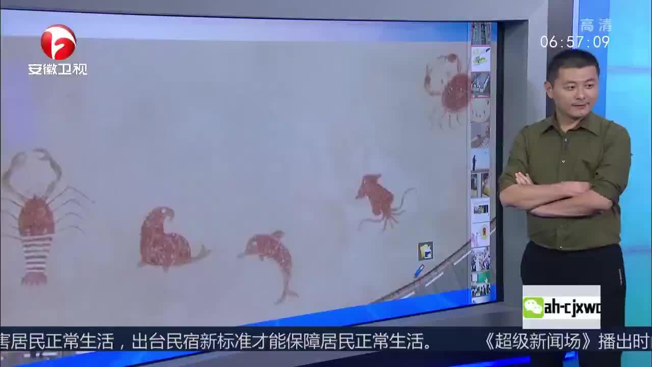 [视频]青岛:环卫工海边清理垃圾 用石块摆出美丽图案