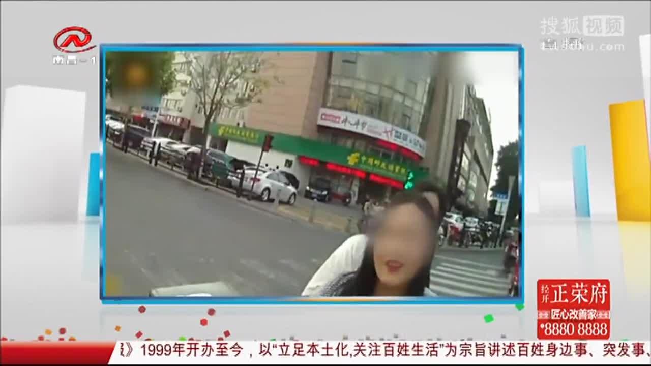 [视频]女子闯红灯被罚对民警撒娇